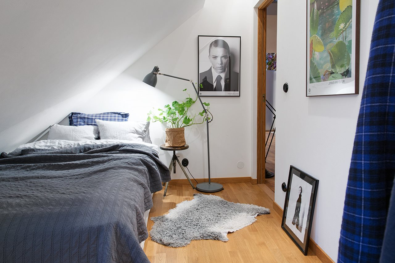 Modern attic apartment in the scandinavian style - Mens bedroom ideas for apartment ...