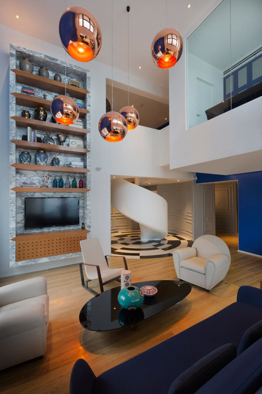 Blue Penthouse Living room with spiral staircase