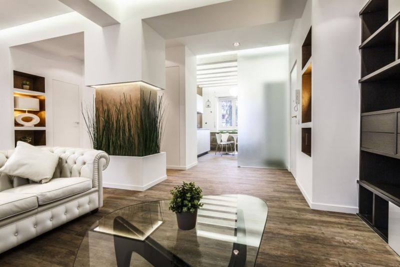 Design of the Apartment in Minimalistic Style - decorative design column completed with live plants
