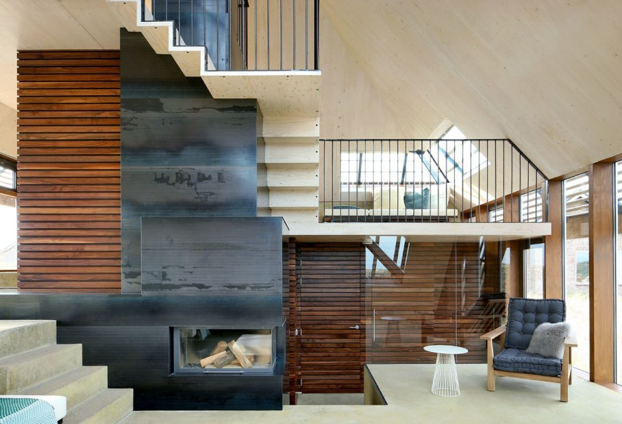 Dune House by Marc Koehler - Living room with fireplace