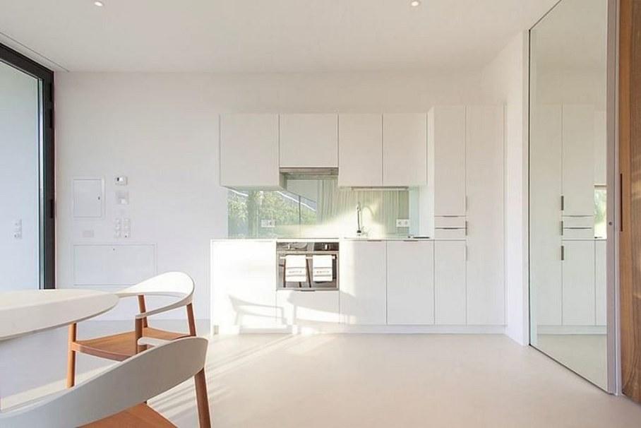 Invisible Mirror Houses - white kitchen