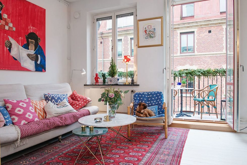 Small Swedish Apartment - a small balcony overlooking a quiet street