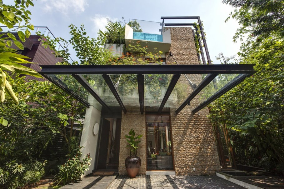 Tan's Garden Villa in Singapore - stone flooring with glass canopy