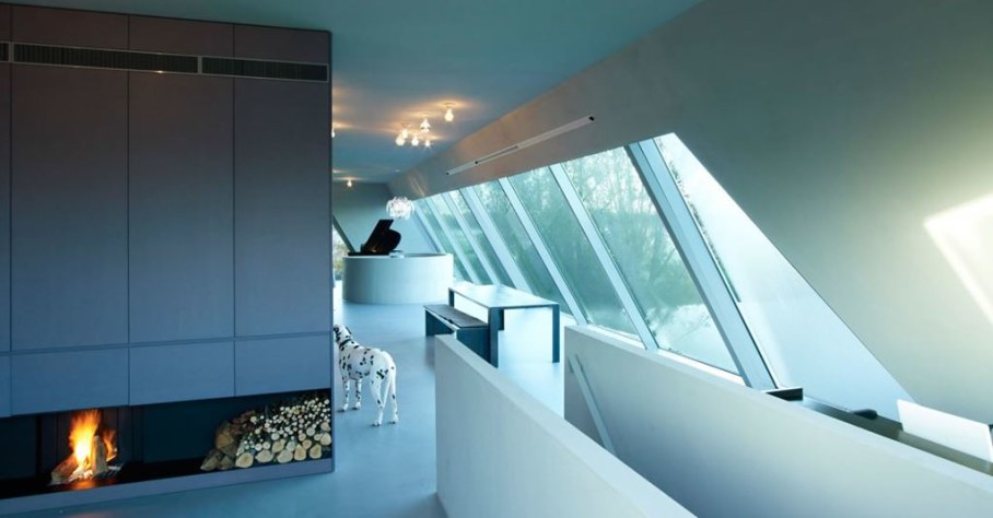 The House Of Unusual Shape From VMX Architects - Living room with Fireplace