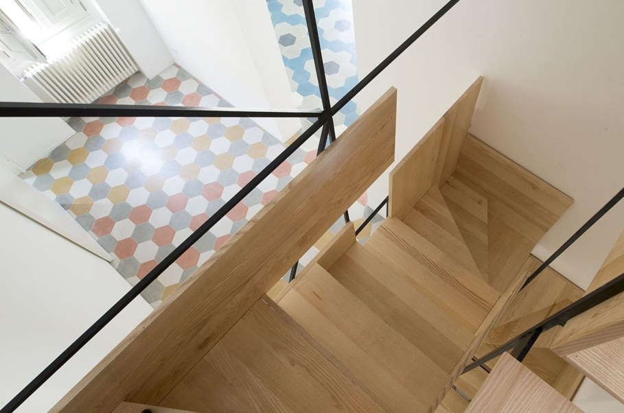 The Stylish Staircase Made of Metal Framework and Wooden Panels 3