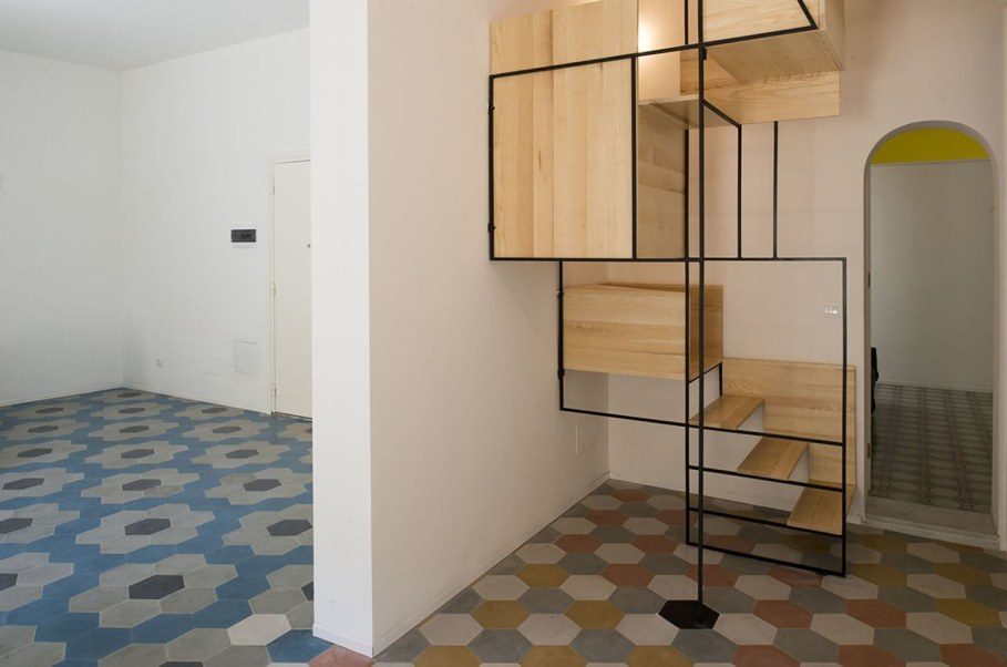 The Stylish Staircase Made of Metal Framework and Wooden Panels
