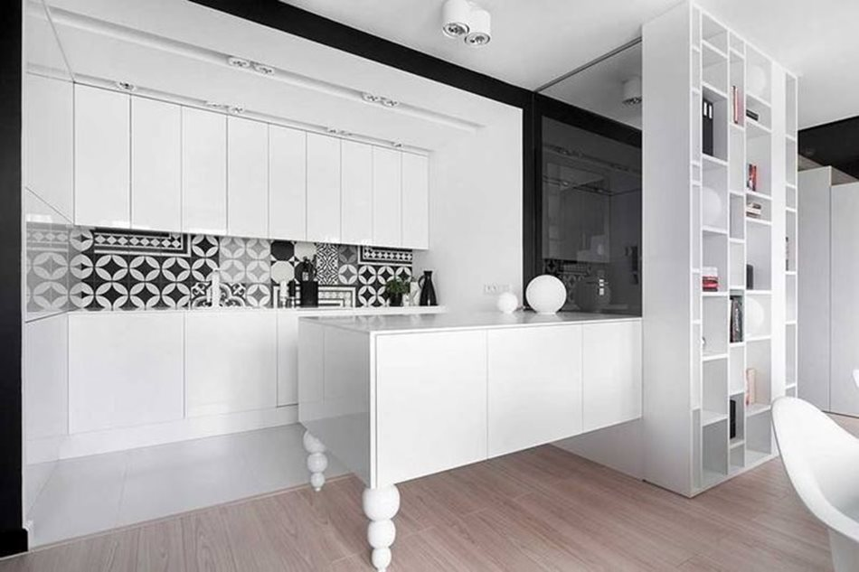 Apartment interior design in black and white colors - Glossy snow-white cupboards and tabletops are used as kitchen furniture