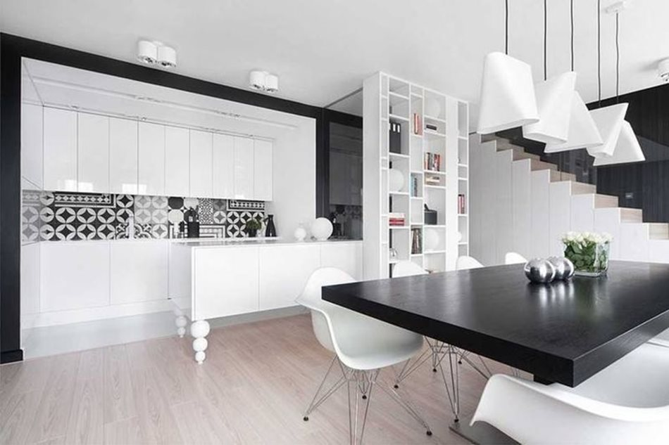 Apartment interior design in black and white colors - The black dining table looks stylish and solidly