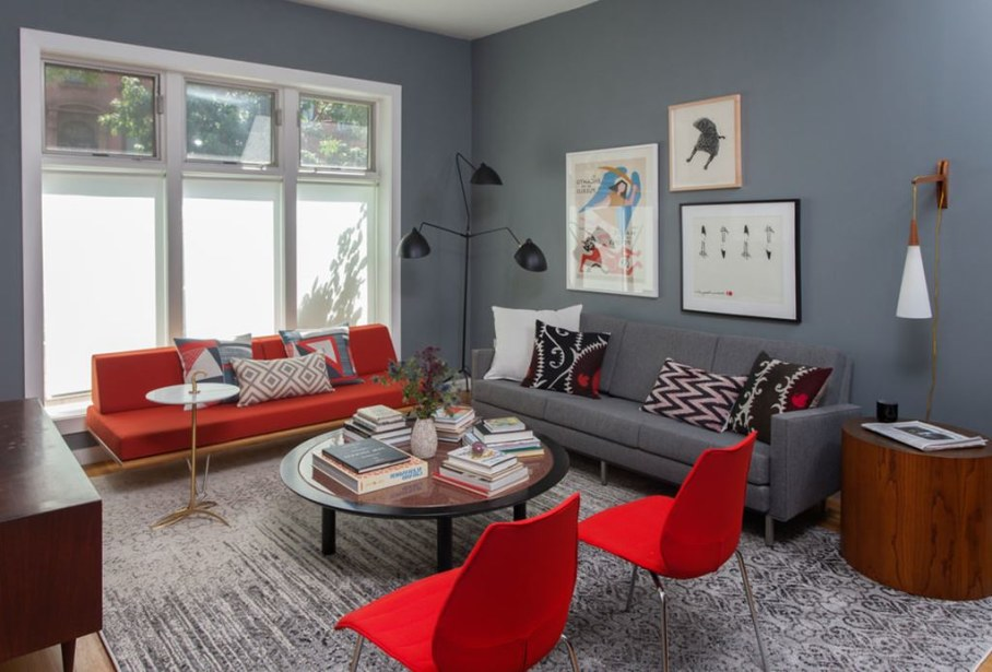 In the living room there are two comfortable straight sofas with contrasting colors