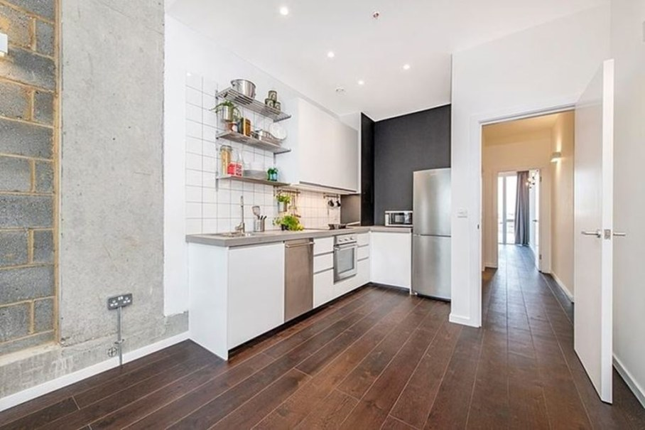 Industrial style London apartment - kitchen and hallway to the bedroom