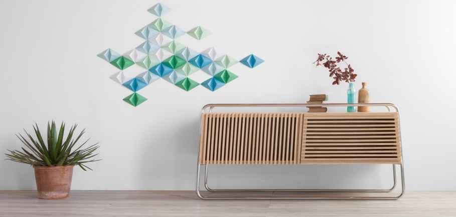 Marcel is a smart sideboard made of wood and tubular metal