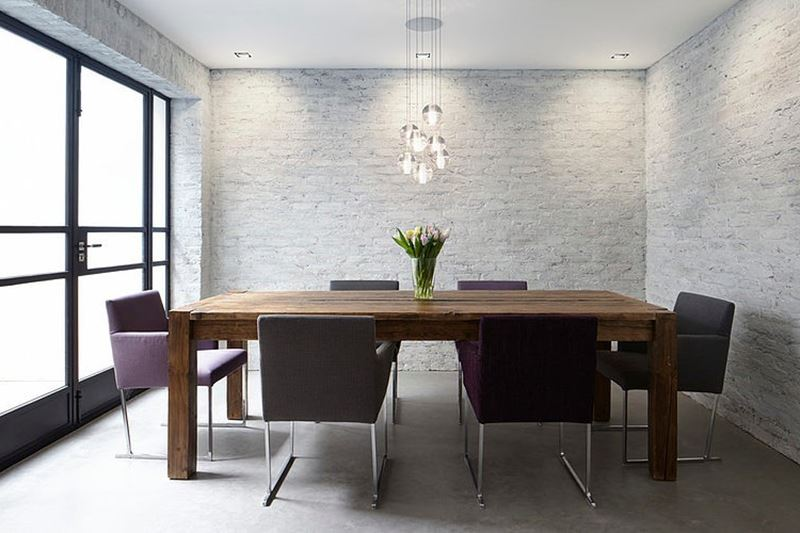 Stylish design of the three-storeyed residence in London - The dining table it is made in a form of coarse cottage-styled item