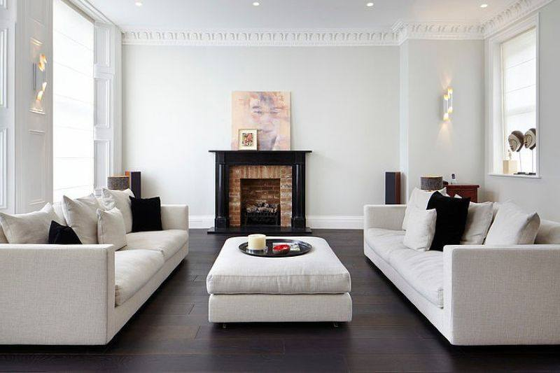 Stylish design of the three-storeyed residence in London - There are two commodious sofas near the fireplace