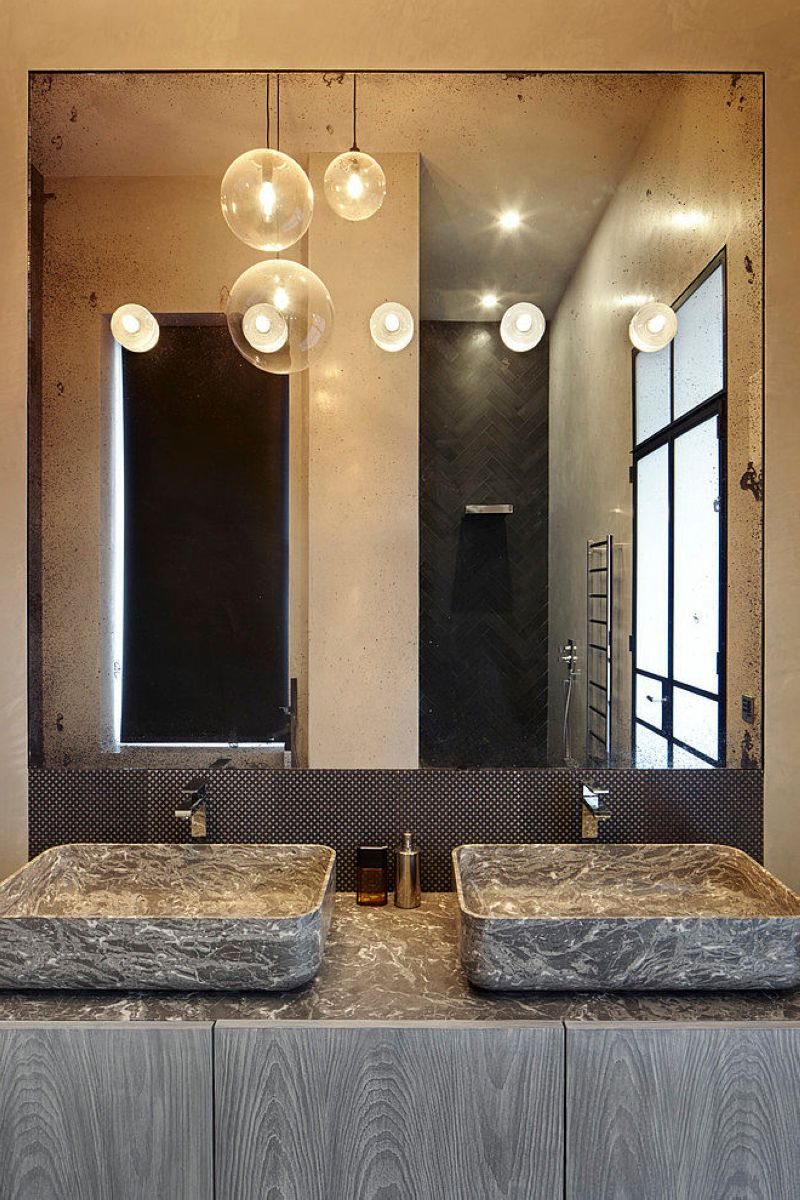 Stylish design of the three-storeyed residence in London - bathroom - There is also a wash-basin for two unusual-shaped sinks, a shower and a wall hung toilet here