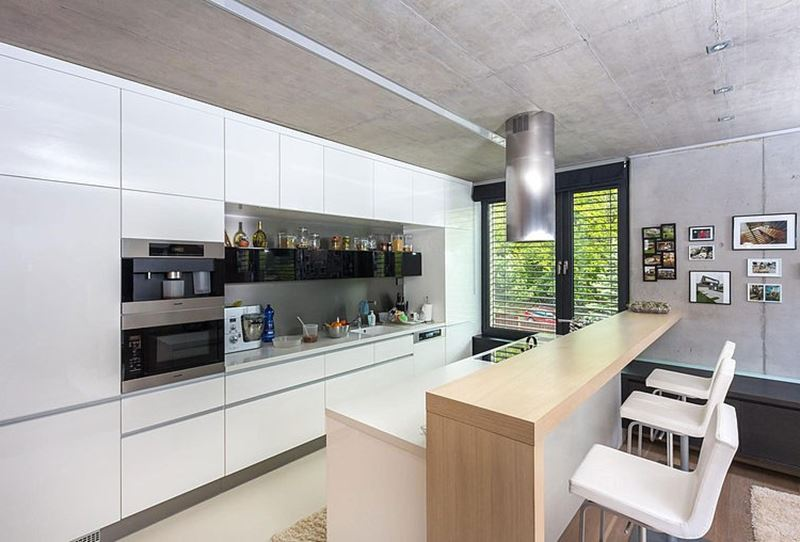 This modern three-story house - White cupboards in the kitchen