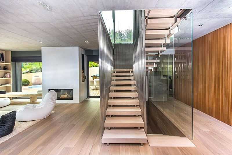 This modern three-story house - living room and staircase