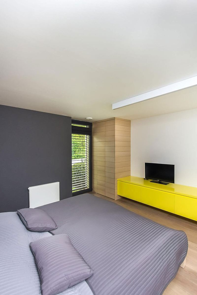 This modern three-story house - spacious bedroom