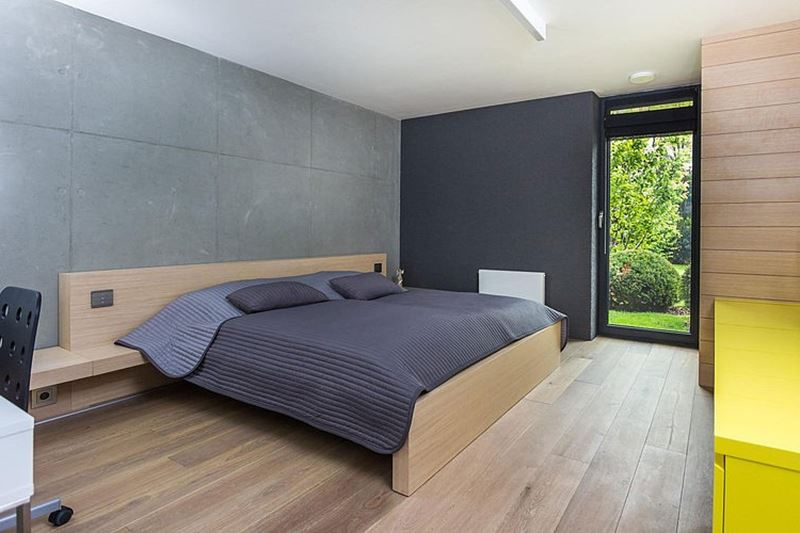 This modern three-story house - the gray color was chosen as the main one for decoration - bedroom