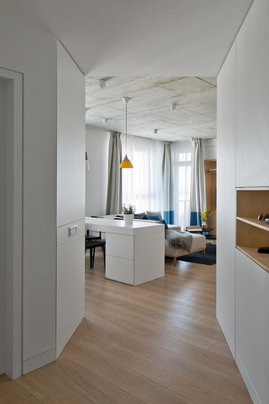 Apartment In Vilnius from Normundas Vilkas - oak floor and unpolished concrete