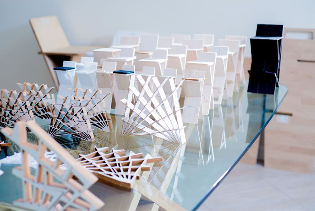 The unsual fan shaped shelves cheft collection for Chair design workshop