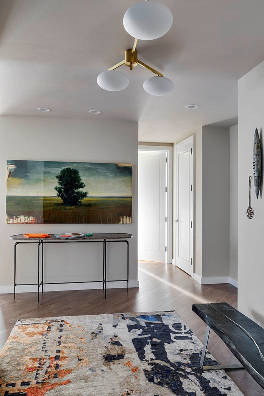 Modern apartment with three bedrooms decorated in eclectic style - The picture with path heading out far away provides additional space extension