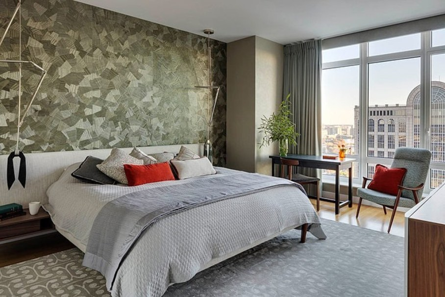 Modern apartment with three bedrooms decorated in eclectic style - bedroom decoration is made in natural tones