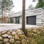 The Modern House On The River`s Shore At The Suburb of Vilnius