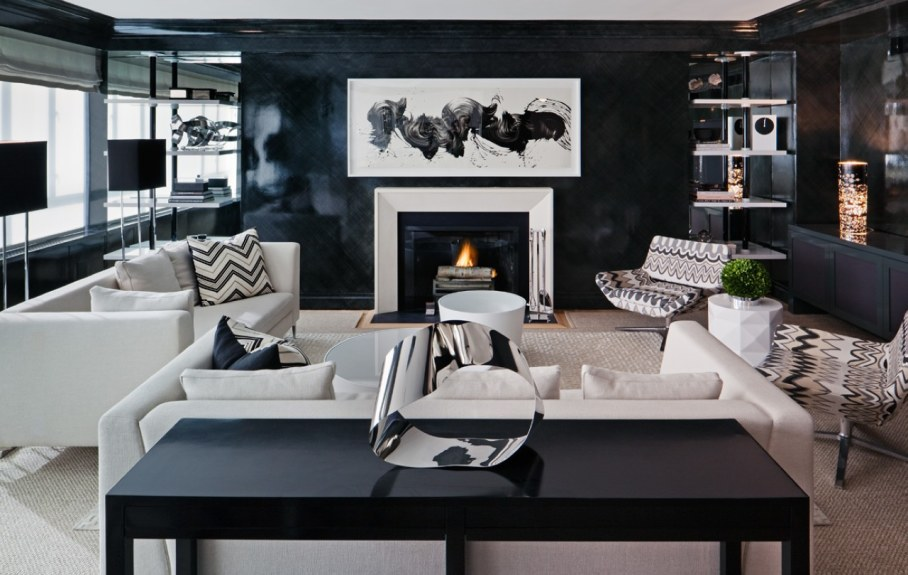 Decorate the zone around the fireplace with prints in frames