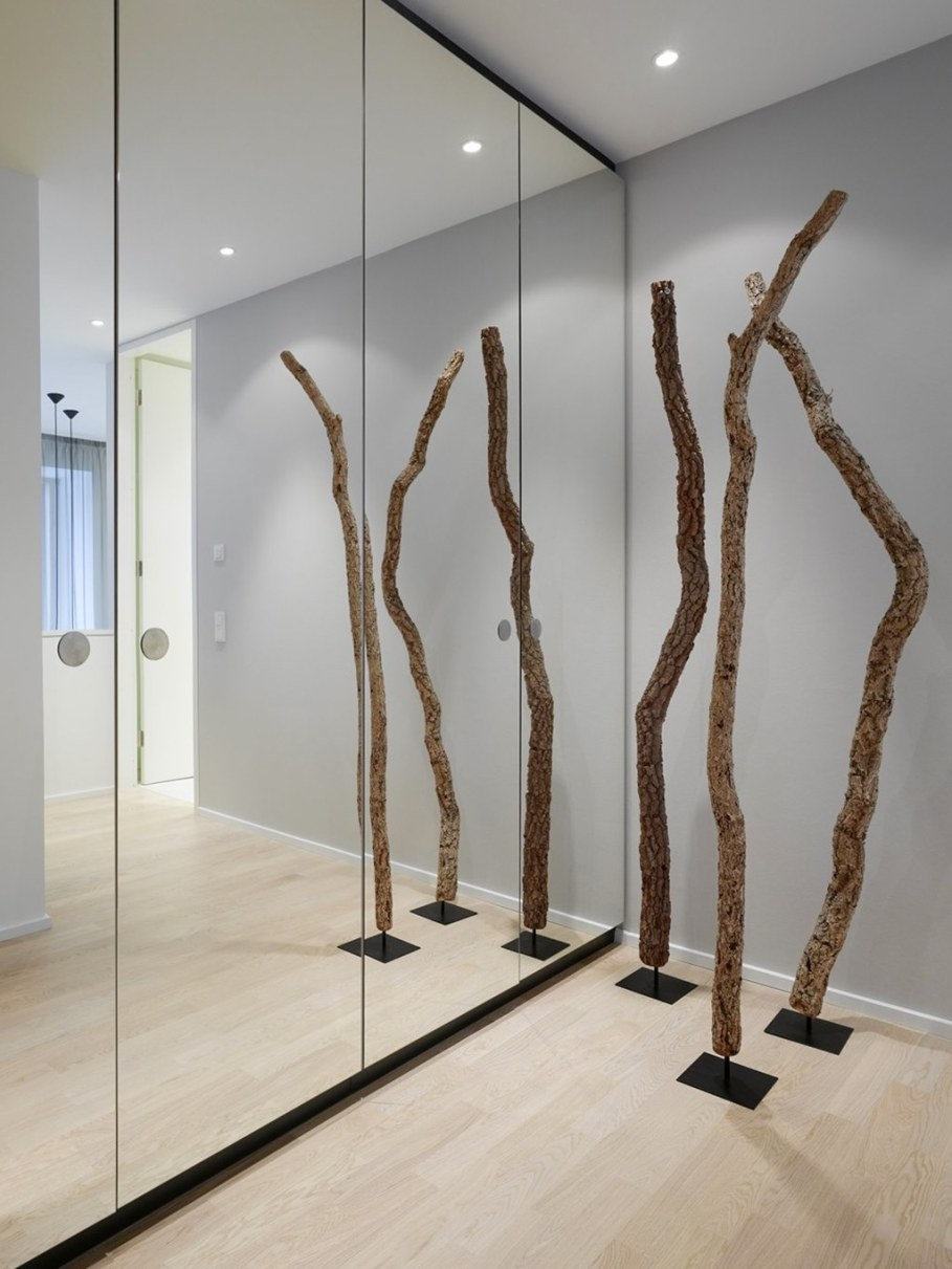 Elegant interior design - Mirrored spacious wardrobe stretches along the length of the hall