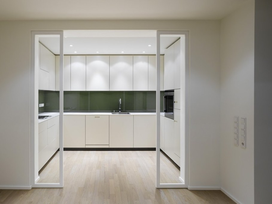 Elegant interior design - The kitchen is separated from the living room by sliding glass doors