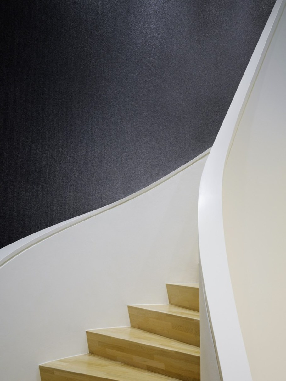 Elegant interior design - curved staircase to the second floor