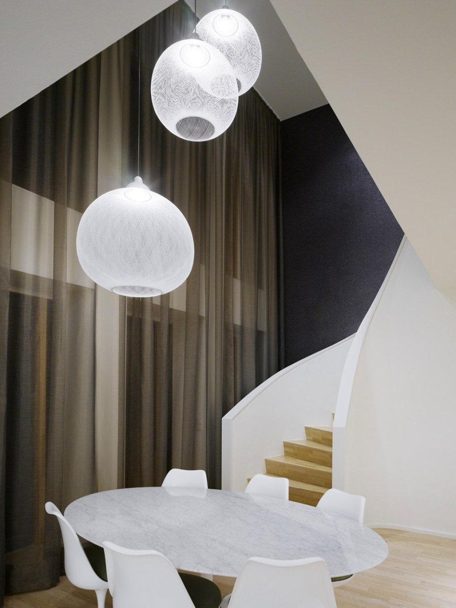 Elegant interior design - dining room and staircase leading to the second floor