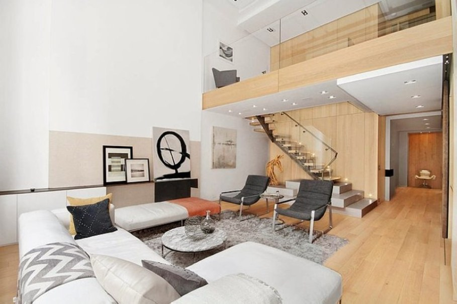 Modern interior design - living room and staircase leading to the second floor
