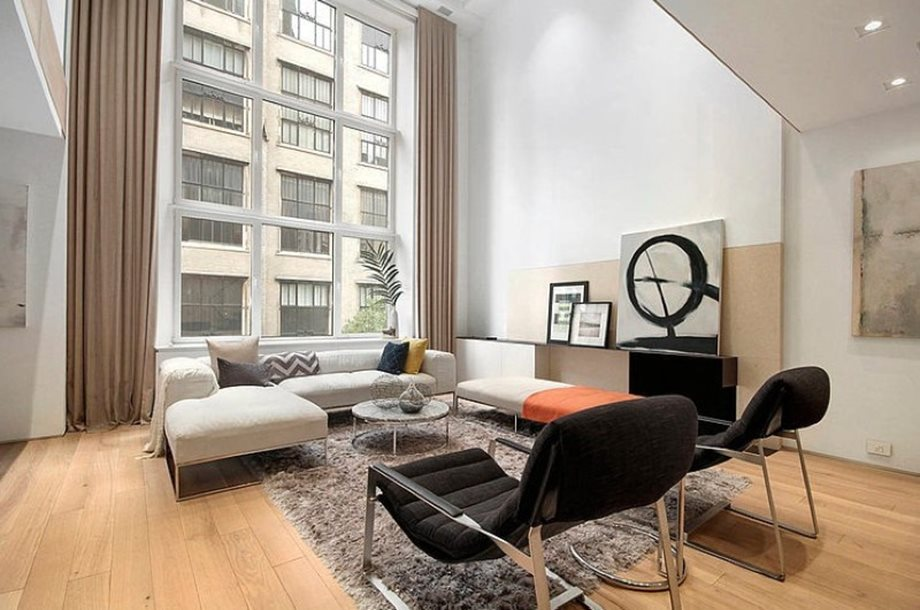 Modern interior design of a duplex apartment in new york for Best interior decorator nyc