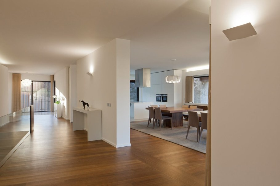 The new house within the walls of an old building - Dining room and hall