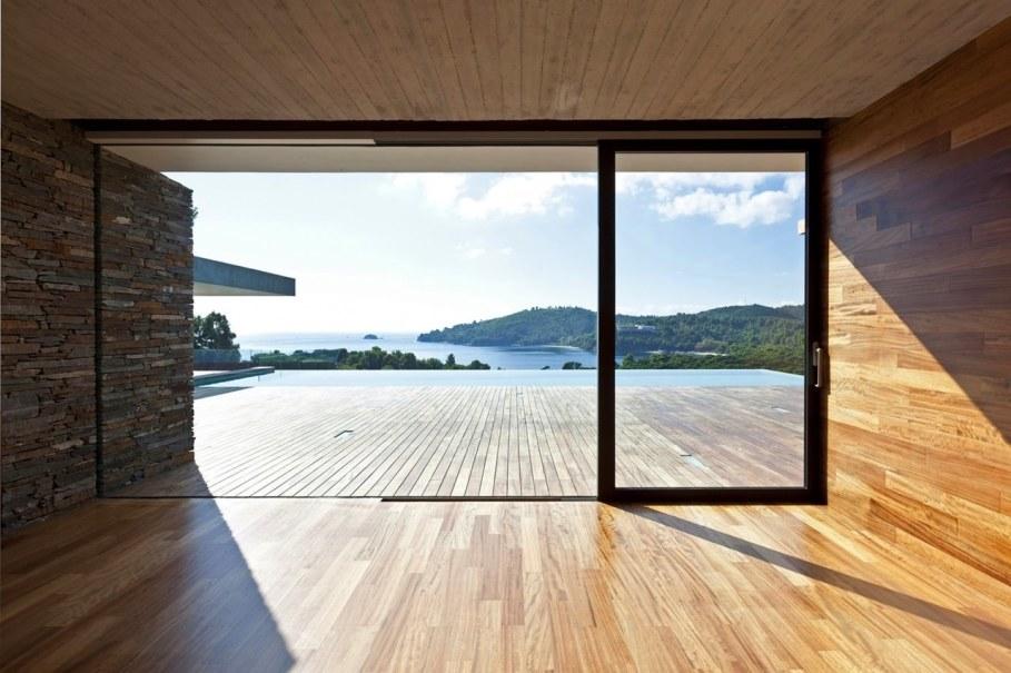 The shining Plane House residence on the Greek island - large glass doors