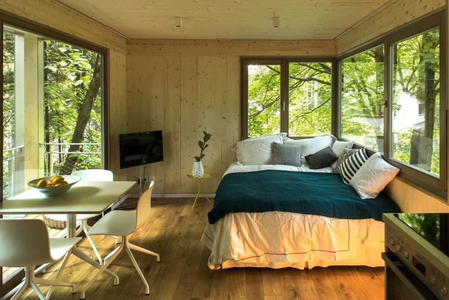 Urban Treehouse by Baumraum - large bed