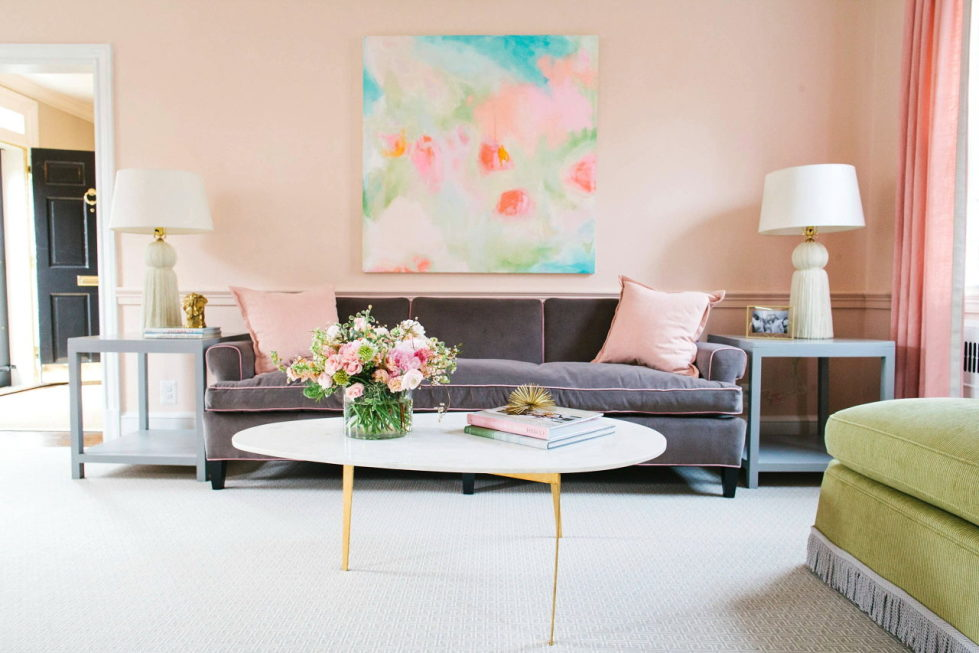 The rose and green colors in the living room interior
